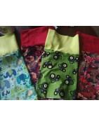 Nákrčníky v různých délkách. Pestré barvy. Dětské, dámské, pánské vzory.